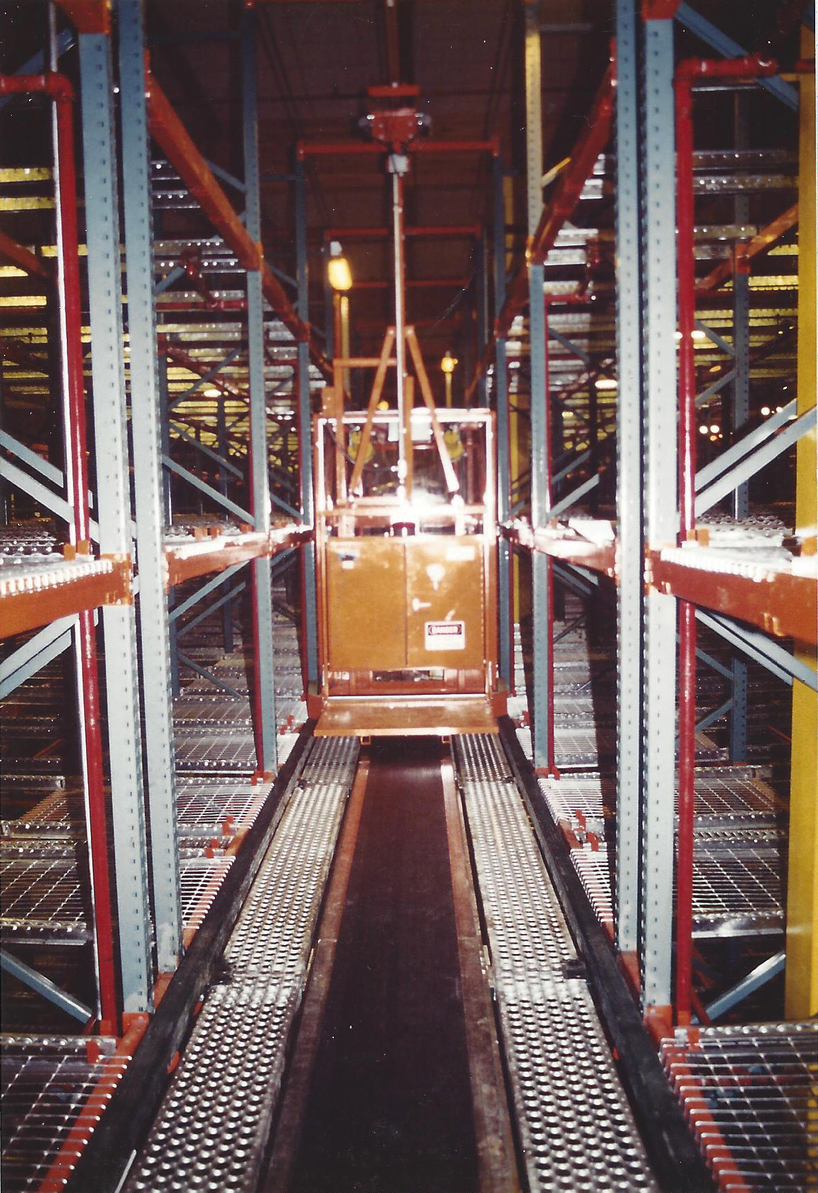 Pallet Flow System with Machine Interface Two Levels High Freezer Application